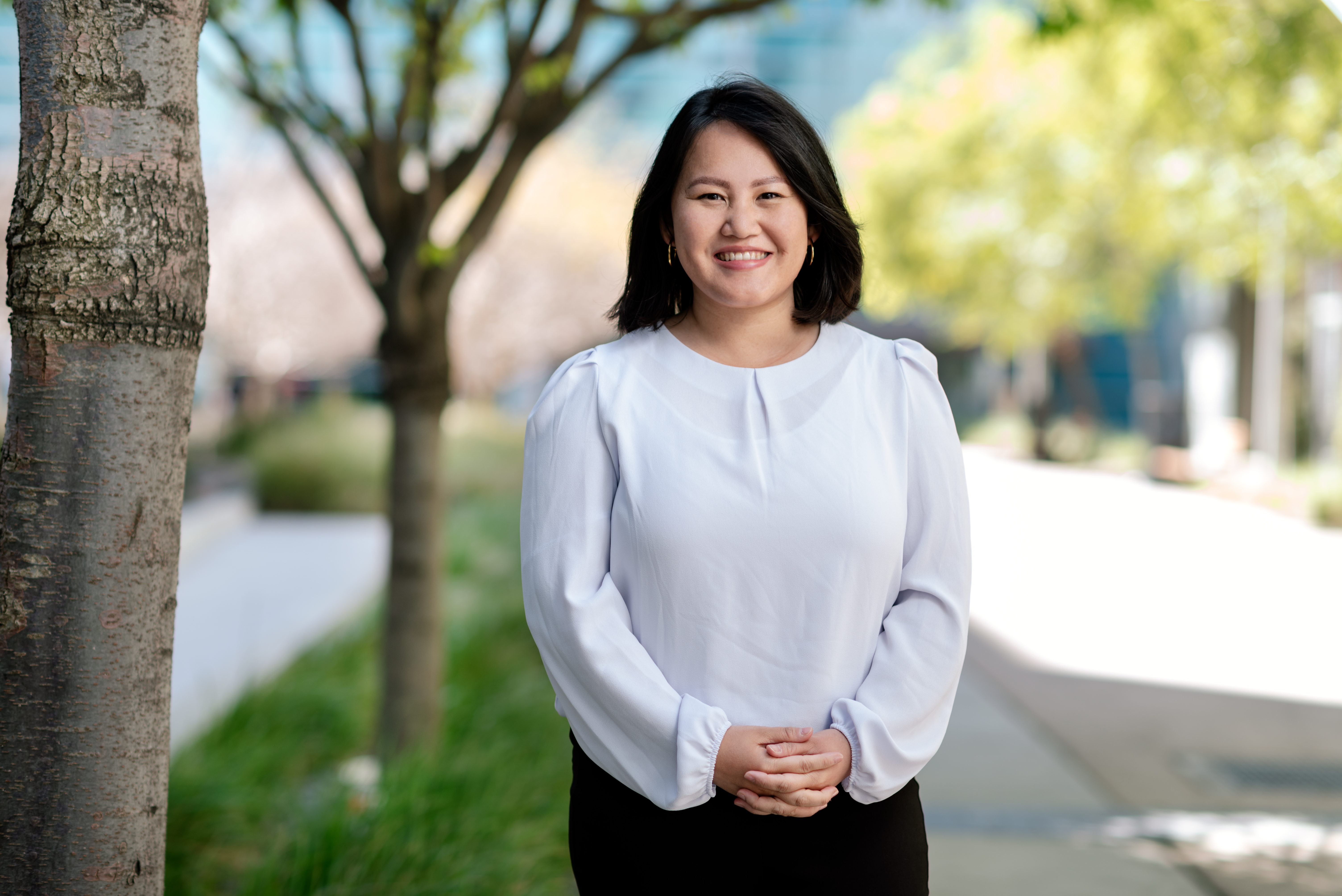 DEI Director Linh Huynh, standing outside Gladstone Institutes