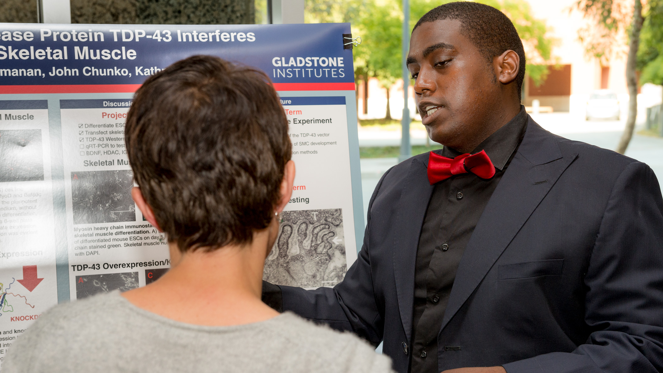 PUMAS intern Damon Williams presenting a poster during his internship