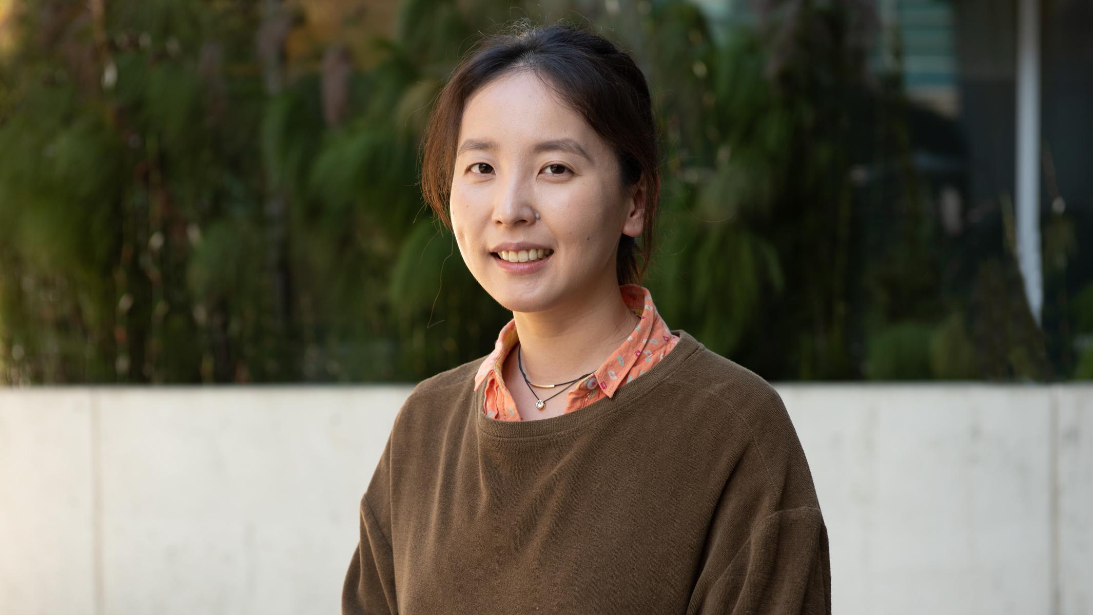 Headshot of Victoria Yoon outside Gladstone building